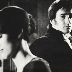 Elizabeth and Darcy; wow, this photograph accurately portrays their relationship.  He is secretly admiring her.