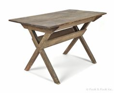 """Pennsylvania painted pine sawbuck table, early 19th c., retaining an old yellow grained surface, 28 1/2"""" h., 48"""" l., 27"""" d."""