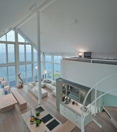 Wohnzimmer Loft mit Galerie - Innenarchitektur Designhaus Mommsen von Baufritz - HausbauDirekt.de