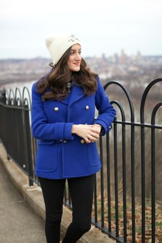 Looking for an easy winter outfit? Pair a colorful winter coat with an embellished beanie for a polished look! This cobalt blue peacoat from J.Crew is chic and cozy.