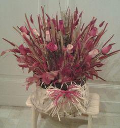 Composizione con fiori di legno e secchi