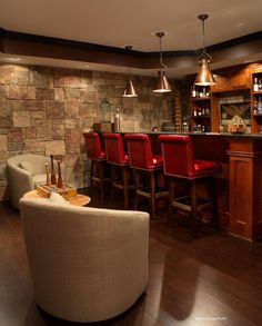 Basement Man Cave Bar etc; this one with mission-style American Cherry bar, leather nailhead high-back stools, mahogany floors, seating area, stacked stone walls and tray ceilings. Basement Bar Designs, Basement Ideas, Modern Basement, Basement Plans, Basement Layout, Gray Basement, Basement Shelving, Rustic Basement, Garage Ideas