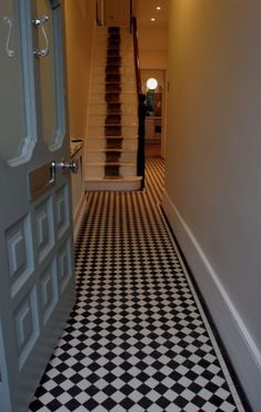 This Victorian style hallway is evident with the luxurious floor tiles, as well as the stripe on the staircase represents a red carpet which displays a luxurious lifestyle. House Design, House, Victorian Homes, House Front, Victorian Hallway, House Styles, Hall Flooring, Hall Tiles, Victorian