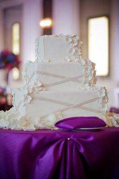 White square wedding cake on purple linens (Photo by Gerber + Scarpelli)
