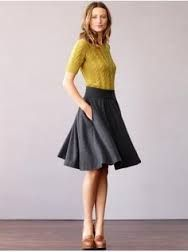 Play with the business skirt by adding bright cardi