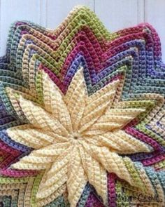 Pinwheel Pillow - Free Pattern looks just like the scrap potholder by maggie weldon. same pattern I thinkThis is absolutely beautiful: Pinwheel Pillow: FREE crochet patternPinwheel Pillow: FREE crochet pattern - Cool, but probably beyond my skill lev Crochet Motifs, Crochet Potholders, Crochet Cushions, Crochet Squares, Crochet Stitches, Crochet Afghans, Crochet Blankets, Knit Or Crochet, Crochet Crafts