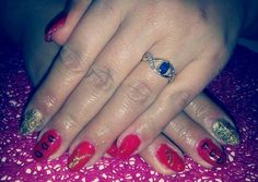 red gail nails decorated on Walentines day in heart and gold aluminum foil :)