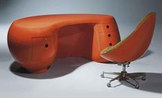 """Here is the orange one with matching chair. Yes, this is the one I want! Maurice Calka's iconic """"Boomerang Desk"""" with matching chair, originally made in very limited edition in 1969. Recently reissued by his son Serge. This is superb space age / atomic age design, so very 'Jetson's'."""