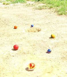 Marbles...make a hole in the dirt with our shoes so we could play marbles....ahhhh the memories
