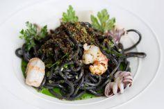 Squid Ink Chitarra with monterey squid, rock shrimp, black garlic, parsley — at America Restaurant. #food #Toronto #restaurant
