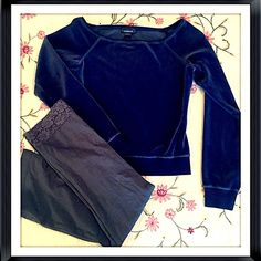 """Beautiful Express velour cropped long sleeve top Beautiful Express navy velour cropped long sleeve top. Measures approx 19"""" long, 21"""" arm length, & 16"""" across chest. Size XS. Cotton/poly blend. Worn once- excellent condition! Bundle to save 10%!NO TRADES or lowballsPlease feel free to make a reasonable offer using the offer button Express Tops Crop Tops"""