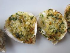 Baked Oysters-  Thinking of my Groom    Nothing is more celebratory than oysters and champagne! This recipe takes raw oysters on the half shell and tops them with parmesan cheese, garlic, and herbs. They're baked until they're buttery and golden.