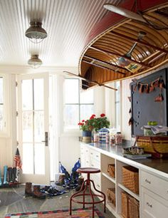 Canoe as Ceiling Decor  Inspired by a restaurant in Vermont, the pantry of an Idaho barn-style house by architects Sandra Vlock and Glenn Arbonies harbors a wood canoe in winter. It also coordinates perfectly with the home's classic American style.