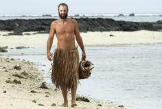 Ed Stafford walks along the beach on Olorua Island in Fiji