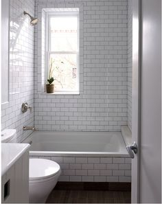 small bathroom...white subway tile with black grout?