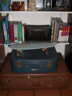 I love old suitcases! and the best part is they also serve as great storage spaces