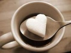 a cup of coffee w/ heart sugar