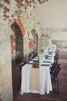 Tables by country at a travel-themed wedding