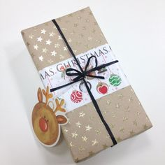 Instead of throwing away left over gift wrap trimmings, use them as a feature! This parcel features Gold Stars rollwrap, Festive Baubles rollwrap (and matching tag) and Black Raffia ribbon. Christmas 2014, Christmas Cards, Holiday, Gold Stars, Getting Organized, Fundraising, Flamingo, Charity, Festive