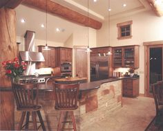 Kitchen with island in this modern log house.