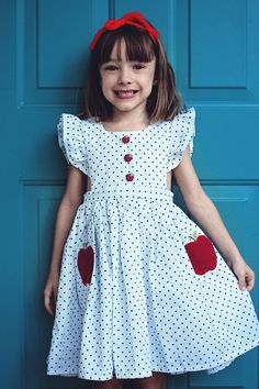 This charming silhouette is classic and never goes out of style! 2 apple pockets on the skirt and apple buttons on the bodice against a black and white polka dotted fabric. White shorties are included with this ensemble. Flutter sleeves provide chest coverage. If intending to layer over a shirt please considering sizing up. Button back with placket for easy dressing.