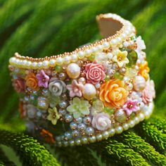 Flower beaded cuff. Where are those little bisque flowers from?