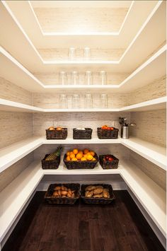 Stunning Walk In Pantry With Grasscloth Wallpaper And White Wraparound  Floating Shelves. Dark Storage Baskets And Glass Canisters Accent The  Shelves.