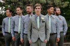 groom in focus while groom's men are out of focus and looking casually away from the camera