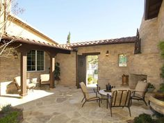 Cozy Southwestern Courtyard: The small roof and sheltered sections within the courtyard intensify the authenticity of the space. From HGTVRemodels.com