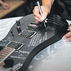 Brides.com: . Guests signed an Ibanez guitar in lieu of a guest book; the idea came from the groom, an avid guitar collector.