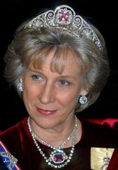 Birgitte, Duchess of Gloucester, wearing the honeysuckle tiara with the pink topaz, or possibly kunzite, centre piece, that was only reunited with the tiara after the death of Queen Mary in 1953.
