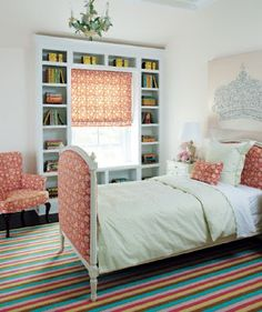 chandelier and upholstery....I love the bookcase around the window
