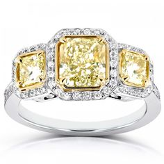 Fancy Yellow Diamond Three-Stone Halo Radiant Engagement Ring 2 CTW in Two-Tone Gold (Certified) *note: links to external affiliate site for Kobelli Fine Jewelry. Big Diamond Wedding Rings, Radiant Engagement Rings, Yellow Diamond Engagement Ring, Moissanite Wedding Rings, Gemstone Engagement Rings, Three Stone Engagement Rings, Vintage Gold Rings, Diamond Stone, Celtic
