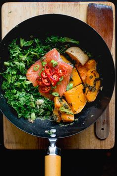 The perfect weeknight dinner: 15 minute coconut salmon with kale.