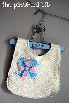 I love pinwheels...and like making bibs for baby gifts...I usually buy pre-embroidered towels...but this would be adorable too!