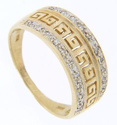 A Greek key design runs across the top third of this 14K yellow gold vintage wedding band while a row of diamonds flanks the pattern on either side. The ring measures 8.3mm wide at its widest point. Circa: 1950. Size: 7 1/4. We can resize.