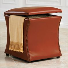 Create new storage space (for blankets by the fire, of course) and extra seating, simultaneously, with this Leather Taylor Storage Ottoman. | Grandin Road Color Crush on Burnt Orange