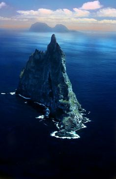 Ball Pyramid - the world's tallest sea stack. It is the remains of a shield volcano formed about 7 million years ago, located southeast of Lord Howe Island in the Pacific Ocean. Ball's Pyramid is part of the Lord Howe Island Marine Park in Australia. Beautiful Places In The World, Places Around The World, Around The Worlds, Amazing Places, Wonderful Places, Places To Travel, Places To See, Travel Stuff, Islands In The Pacific