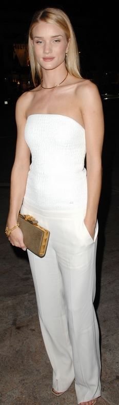 Who made  Rosie Huntington-Whiteley's white strapless jumpsuit, bow clutch handbag, and gold jewelry?