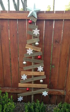 Scrap wood Christmas yard decor with a dash of dollar store ornaments! Wooden Christmas Crafts, Diy Christmas Decorations For Home, Pallet Christmas Tree, Primitive Christmas, Rustic Christmas, Christmas Projects, Christmas Art, Holiday Crafts, Primitive Crafts