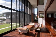 Black framed fly screens allow the light to enter and breeze to ventilate the house. House Insects, Cardboard Model, Second Floor, Glass Door, Interior And Exterior, Indoor Outdoor, Architecture Design, Modern Design, High Ceilings