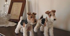 Needle Felted Wire Fox Terriers.  Don't know who made them, but they are really nice!.