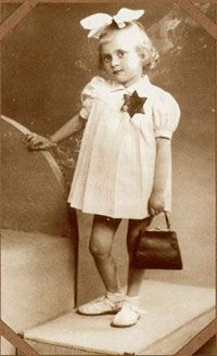 "France, girl in white with dark Jewish star with inscription ""Juif"" (""Jew"")"