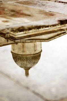 Reflections in puddles outside The National Gallery