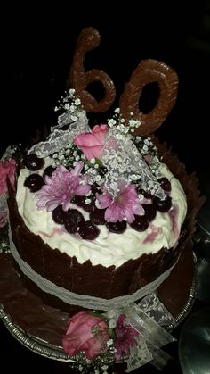 Black forest and cream with chocolate side panels birthday cake.