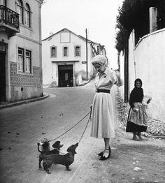 Baroness Walpurga von Friesen walking her dogs. Photograph by Gordon Parks. Cascais, Portugal, 1950.