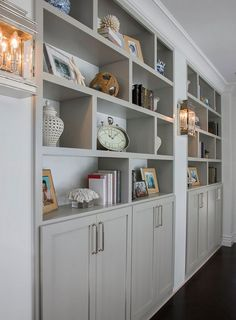Example of gray shelves and cabinets. Not our style/on point but as a visual idea in the family room on both sides of the bedroom/den.  We will likely have wine glasses etc. So some closed off or glass cabinets could be great as part of 1 or 2 (of the three) locations.  Find a gray color/shade that works with concrete floor.     Bookshelves painted with Mindful Gray Benjamin Moore.