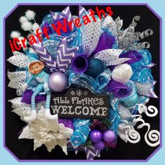 This cutie is perfect for your winter door and will add a touch of humor to it too!  Product Description: Handmade Wire Wreath Form 10 White Iridescent Snowball Mesh 10 Wide Metallic Silver Mesh 10 Winter Blue Snowball Mesh 2.5 Wired Purple And White Chevron ribbon 2.5 Wired White with Silver Polka Dots ribbon Coordinating Christmas balls in white, blue and purple Coordinating accent pieces All Flakes Welcome wood sign Plush elf  Wreath Measures approx. 18 in diameter, 7 Deep  The elements…