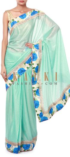 Buy Online from the link below. We ship worldwide (Free Shipping over US$100). Product SKU - 316737. Product Price - $69.00. Product link - http://www.kalkifashion.com/turq-shimmer-saree-featuring-in-floral-printed-border-only-on-kalki.html