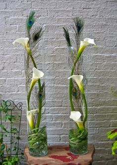 I love this. We could use the bleached/white peacock feathers instead. Maybe high-boys? Or use mini callas for a shorter centerpiece.